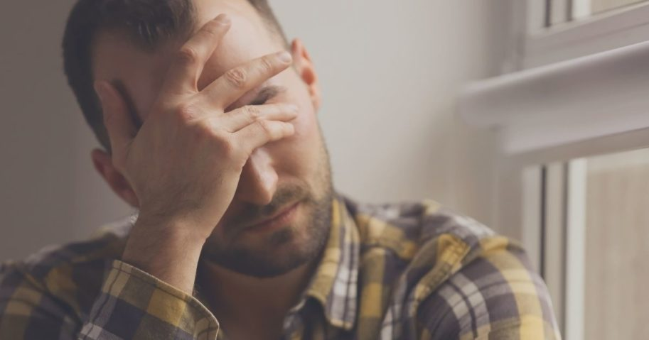 A person struggling with depression is pictured in the stock image above.