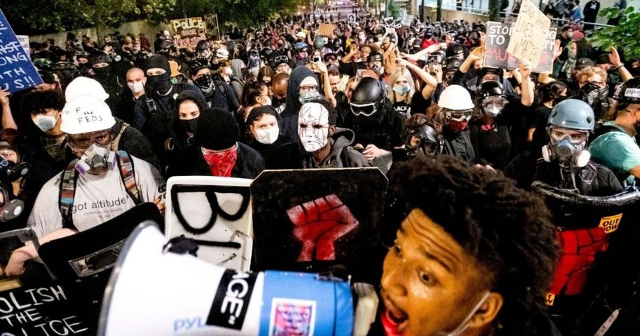Black Lives Matter protesters march through Portland, Oregon, after rallying at the Mark O. Hatfield United States Courthouse on Aug. 2, 2020.