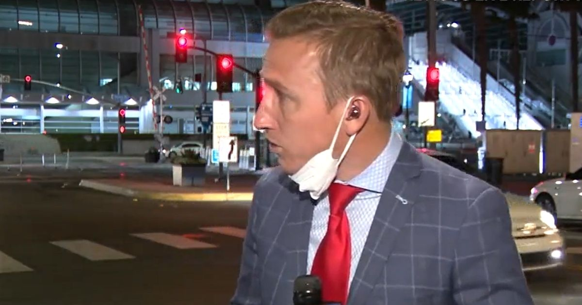 KSWB-TV reporter Jeff McAdam, reporting from near the San Diego Convention Center, turns to look after gunshots rang out behind him.