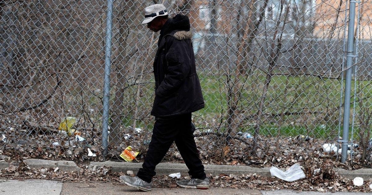 An unidentified man walks down Michigan Ave. in Chicago's Bronzeville neighborhood on April 6, 2020.