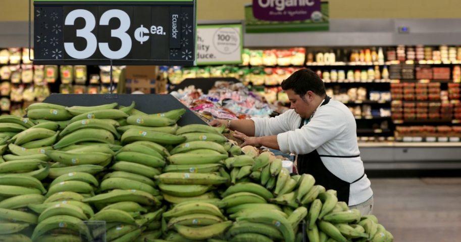 Walmart employee Dayngel Fernandez works in the produce department stocking shelves at a Walmart store on Feb. 19, 2015, in Miami.
