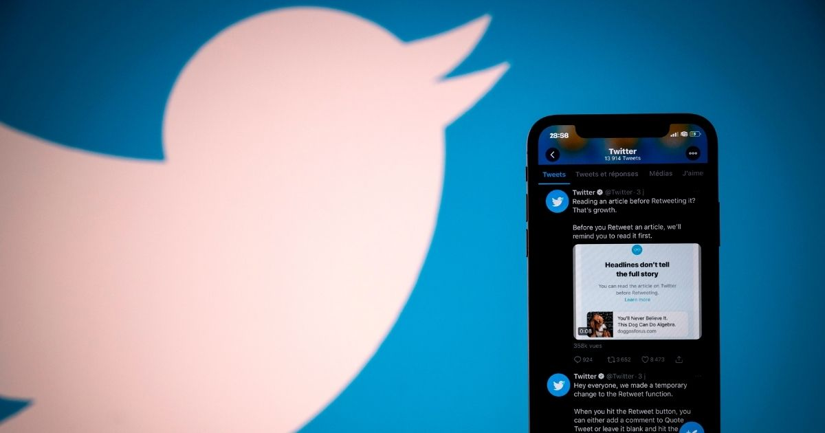 This photograph taken on Oct. 26, 2020, shows the logo of the social network Twitter displayed on the screen of a smartphone and a tablet in Toulouse, southern France.