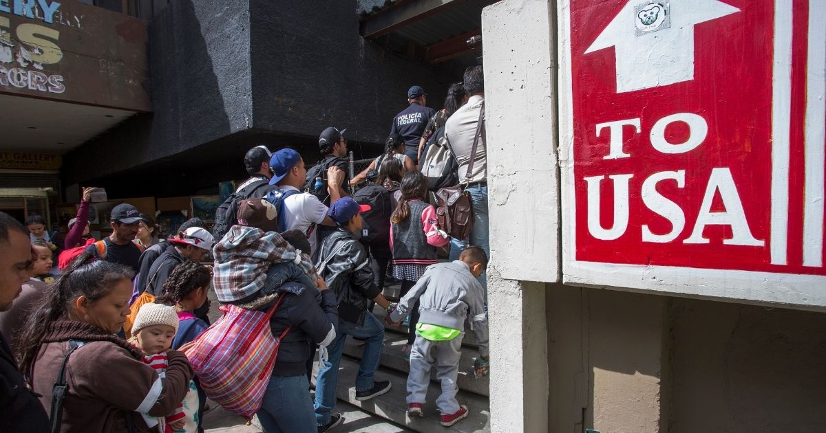 Mexican migrants arrive at a U.S. port of entry.