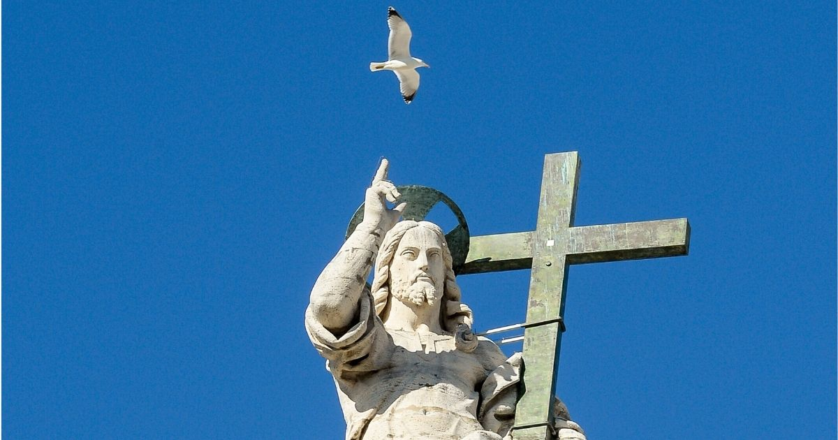 A statue of Jesus is pictured on the top of St. Peter's Basilica as Pope Pope Francis (unseen) delivers a speech during his weekly general audience in St. Peter's square at the Vatican, on March 5, 2014.