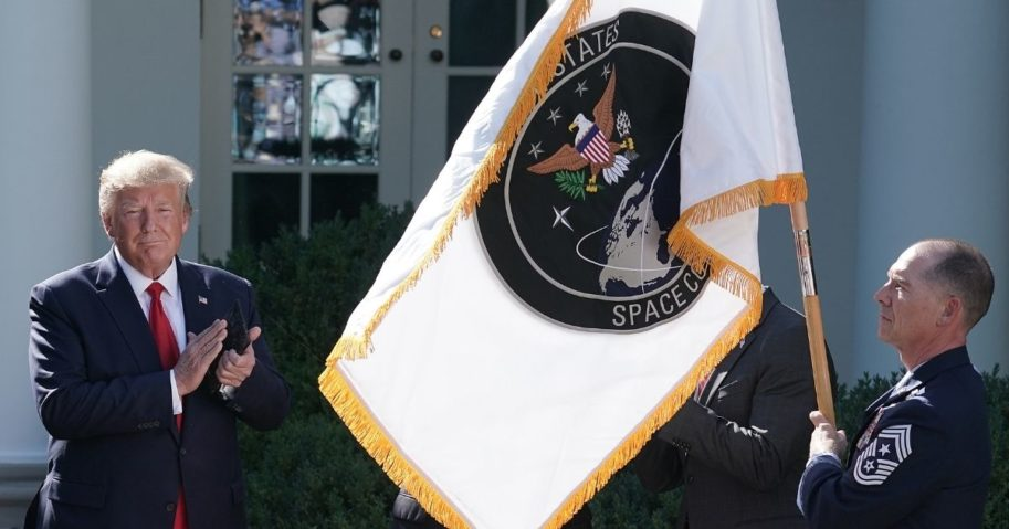 Then-President Donald Trump applauds the flag for the newly established Space Command at the White House in August 2019.