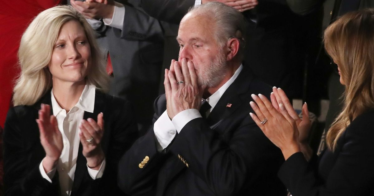 Radio legend Rush Limbaugh reacts during the State of the Union address on Feb. 4, 2020, in Washington, D.C., as his wife, Kathryn (left) and First Lady Melania Trump look on. Limbaugh was awarded the Presidential Medal of Freedom that day. Limbaugh died on Feb. 17, 2021, at the age of 70.