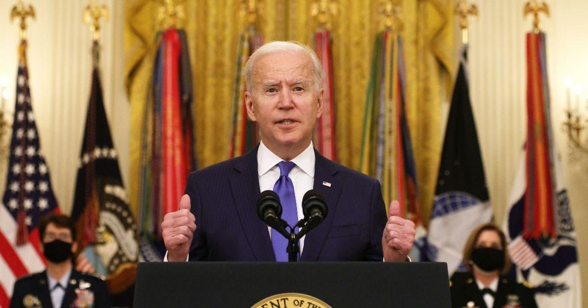 President Joe Biden speaks Monday at the White House during a ceremony for International Women's Day.