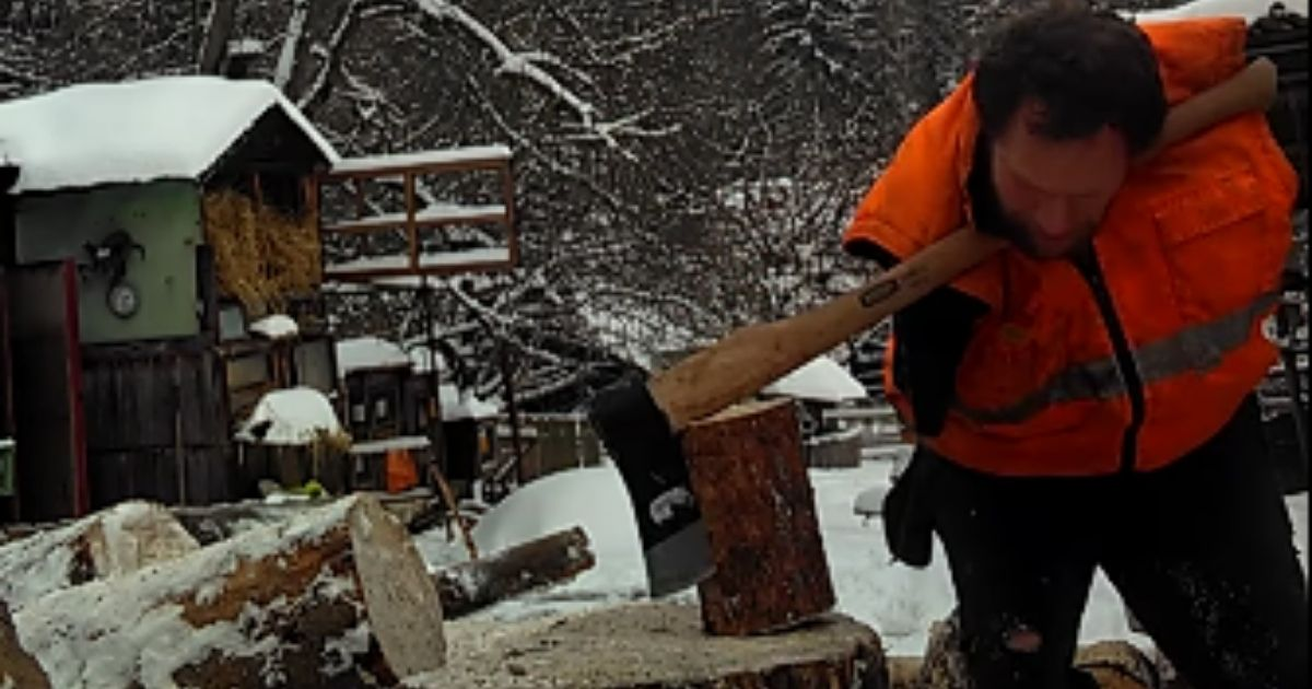 Petr Packa Schneider, who lost his arms at age 12, chops wood in a February 2021 video that went viral.