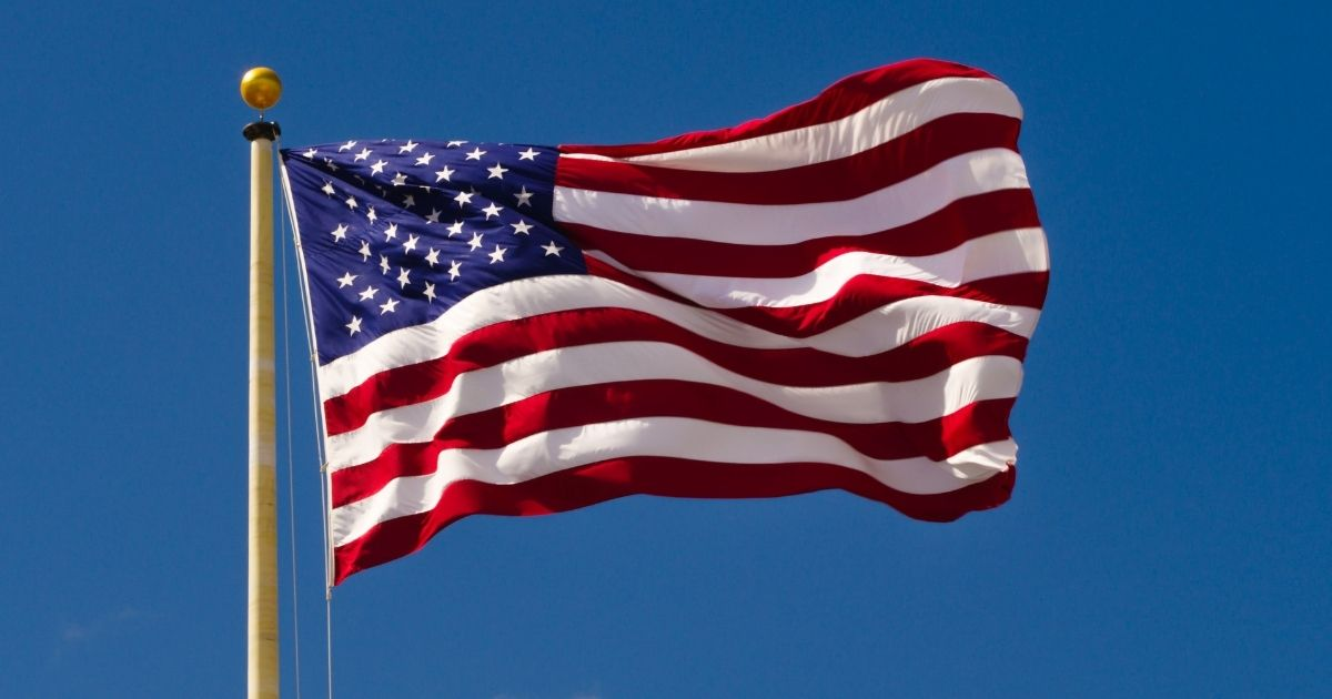 This stock photo portrays an American flag at full-mast. Andrew Almer says his condominium association is threatening him with a $200 a day fine if he continues to fly an American flag on his back porch in Fargo, North Dakota.