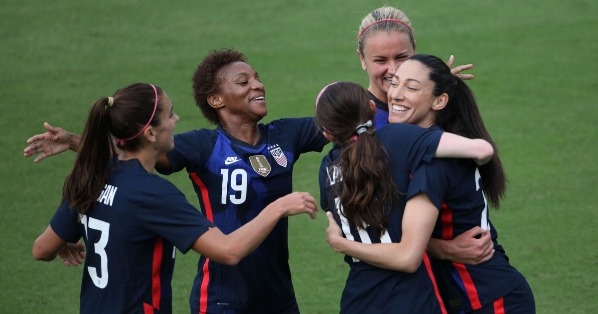 The USA team celebrates after scoring a first half goal against Brazil during their SheBelieves Cup international soccer tournament game at Exploria Stadium in Orlando, Florida on Feb. 21, 2021.
