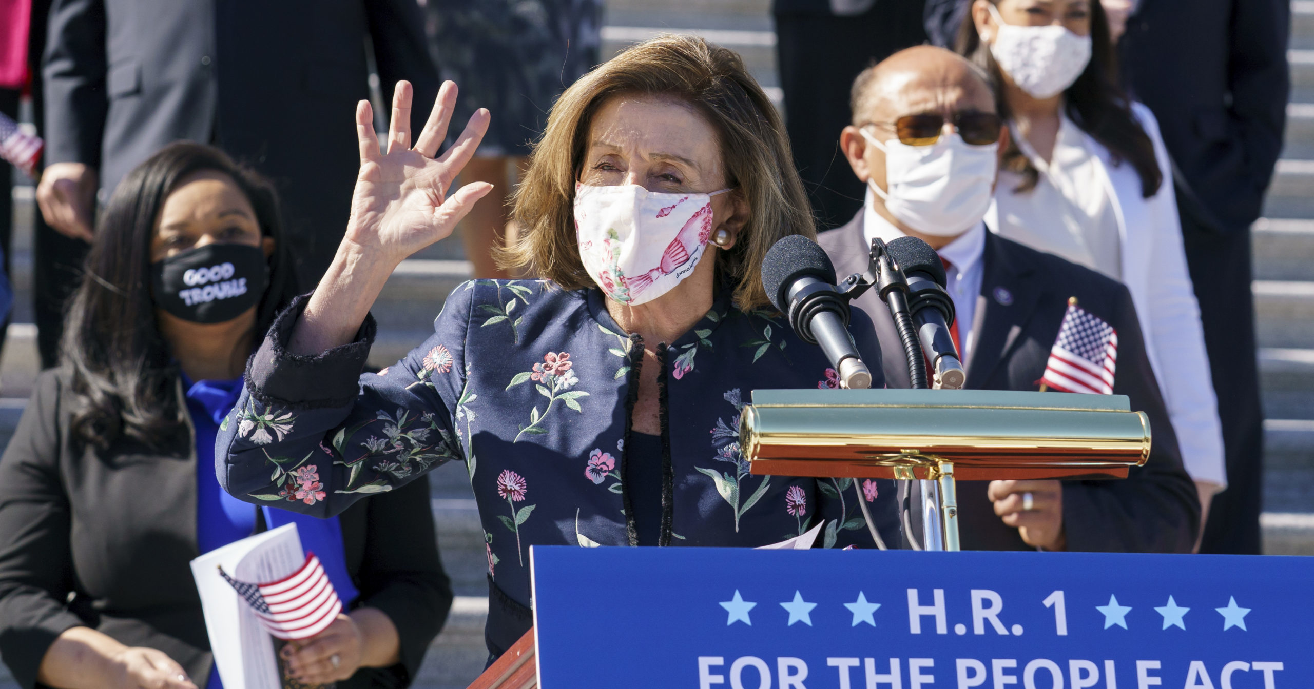Speaker of the House Nancy Pelosi and the Democratic Caucus gather to address reporters at the Capitol in Washington, D.C., on March 3, 2021. (
