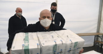 Men unloading COVID vaccine