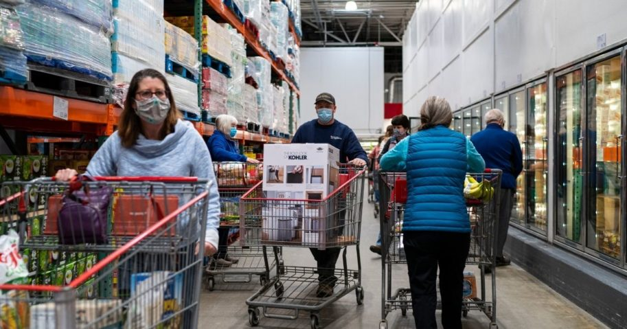 Shoppers search for items at a Costco store on Feb. 26, 2021, in Colchester, Vermont.