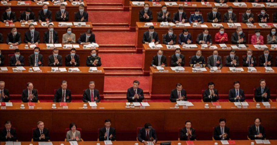 Chinese President Xi Jinping, center, and lawmakers applaud during the closing session of the National People's Congress at the Great Hall of the People on March 11, 2021, in Beijing, China.