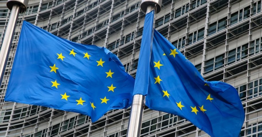 European Union flags fly outside the headquarters of the European Commission in Brussels on March 11, 2021.