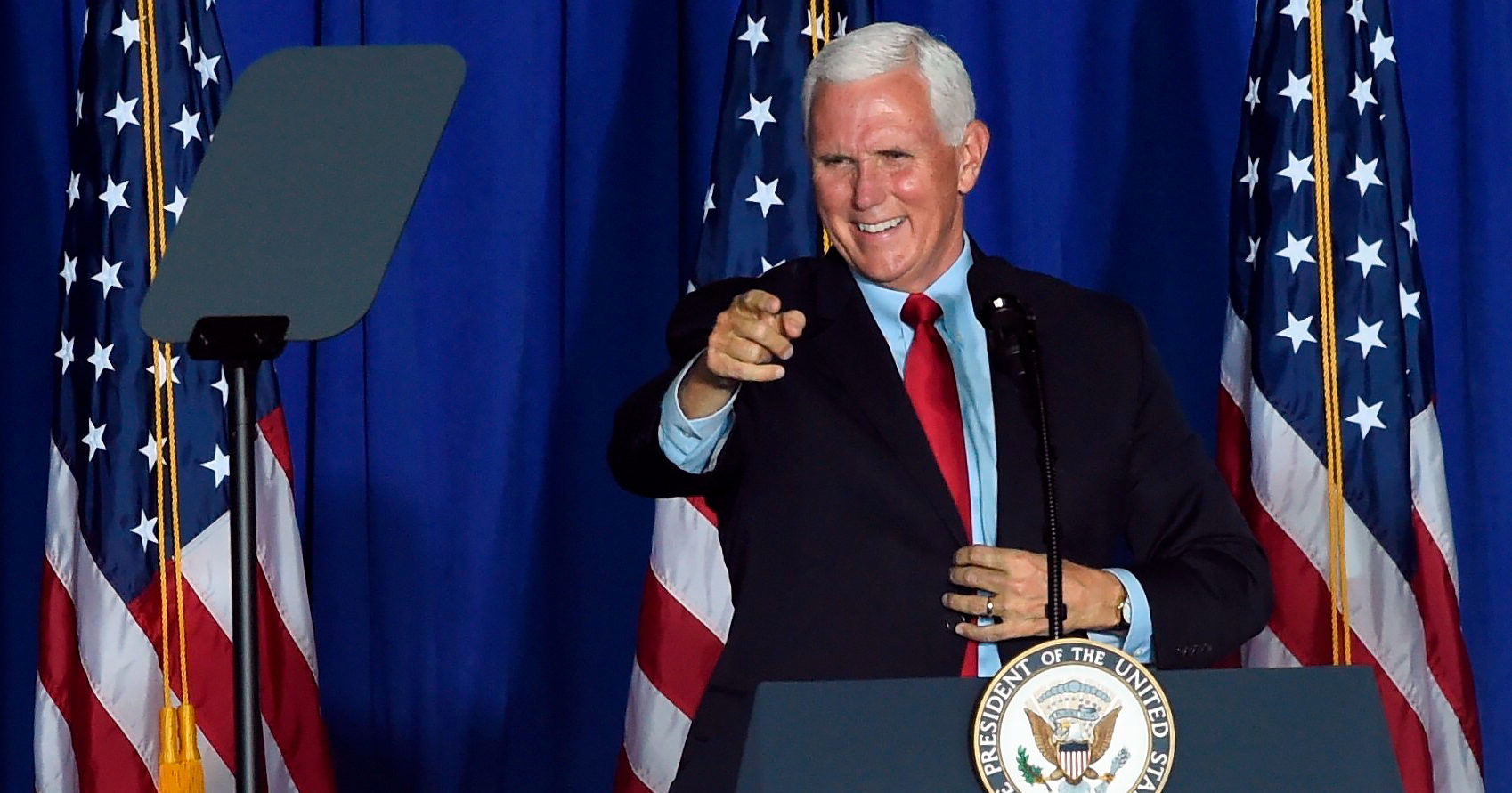 Then-Vice President Mike Pence speaks during a campaign rally at an airplane hangar in Greenville, South Carolina, on Oct. 27.