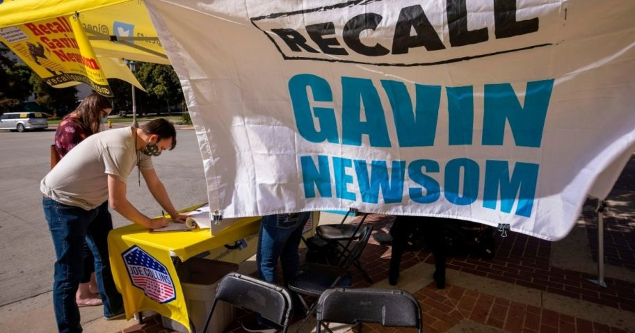 A man signs a petition to recall California Gov. Gavin Newsom near Pasadena City Hall in Pasadena, California, on Feb. 28, 2021.