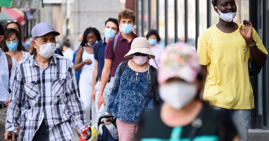 People wear face masks in Chinatown on Aug. 3, 2020, in New York City.