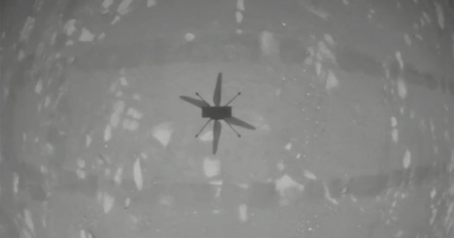 In this image from NASA, NASA's experimental Mars helicopter Ingenuity hovers above the surface of Mars on Monday.