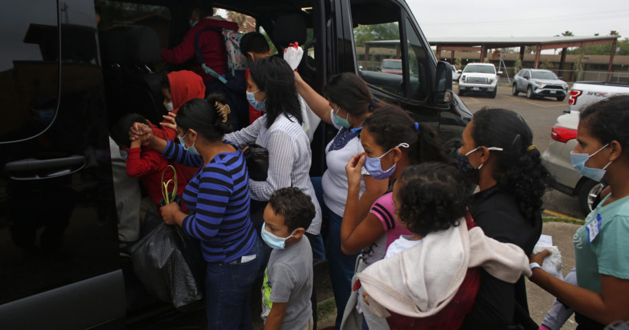 Migrants board a van at Our Lady of Guadalupe Catholic Church in Mission, Texas, on March 28, 2021.