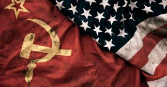 Photography of a grungy old Soviet Union and United States of America flags are pictured.