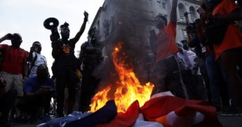 Rioters burn a U.S. flag at Black Lives Matter Plaza near the White House on July 4, 2020, in Washington, D.C.