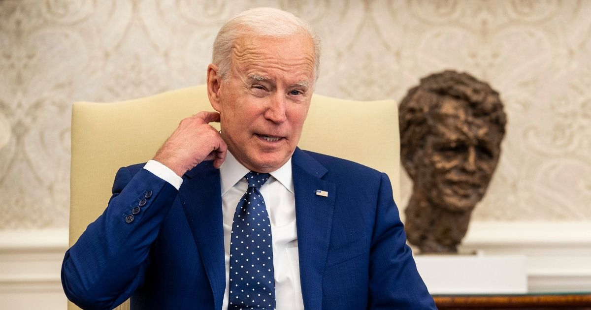 President Joe Biden meets with members of the Congressional Asian Pacific American Caucus Executive Committee in the Oval Office on Thursday in Washington, D.C.