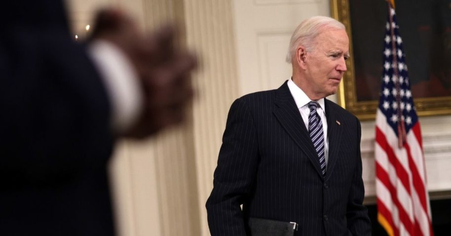 President Joe Biden listens to a question from a reporter after forgetting to put on a mask when he left the podium following remarks on the state of coronavirus vaccinations at the State Dining Room of the White House in Washington on Tuesday.
