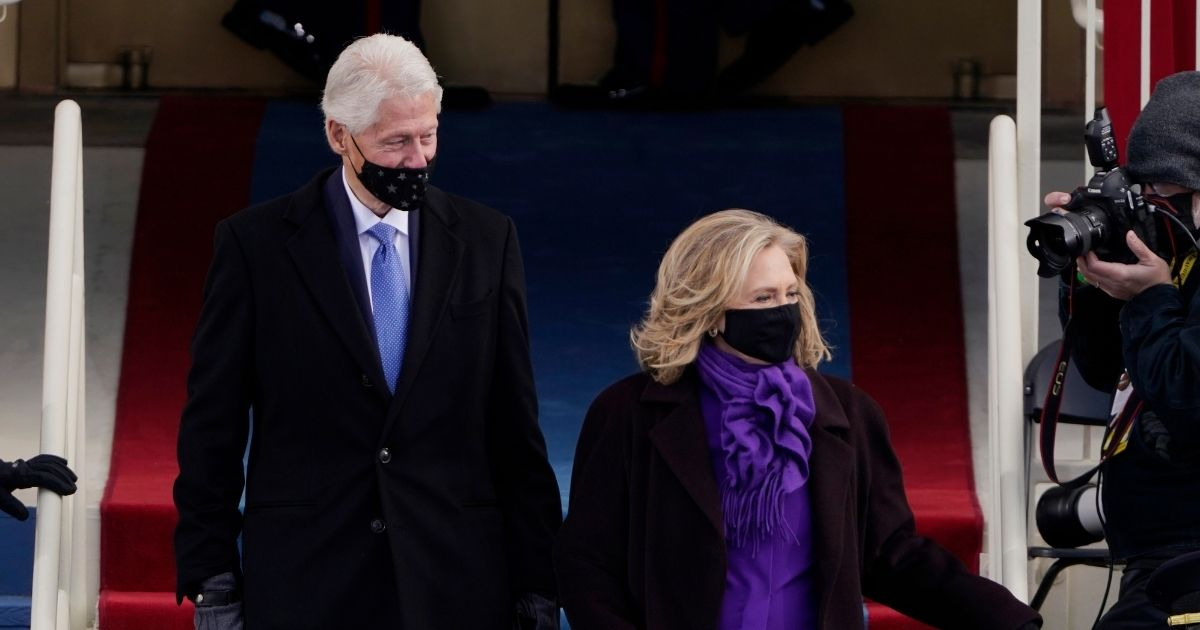 Former President Bill Clinton and his wife former Secretary of State Hillary Clinton arrive for the 59th inaugural ceremony on the West Front of the U.S. Capitol on Jan. 20 in Washington, D.C.