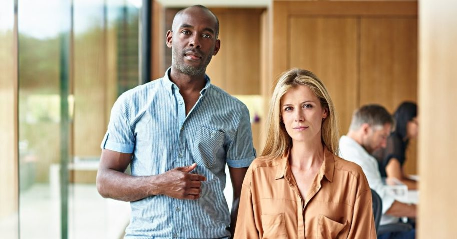 In this stock photo, a black man and a white woman stand side by side. A high school teacher at a Loudoun County public school in Ashburn, Virginia, is facing criticism for pushing a student to point out racial differences between two people in a photo.