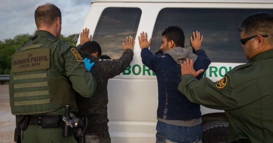 Border Patrol agents apprehend illegal immigrants shortly after they crossed the border from Mexico into the United States on March 26, 2018, in the Rio Grande Valley Sector near McAllen, Texas.