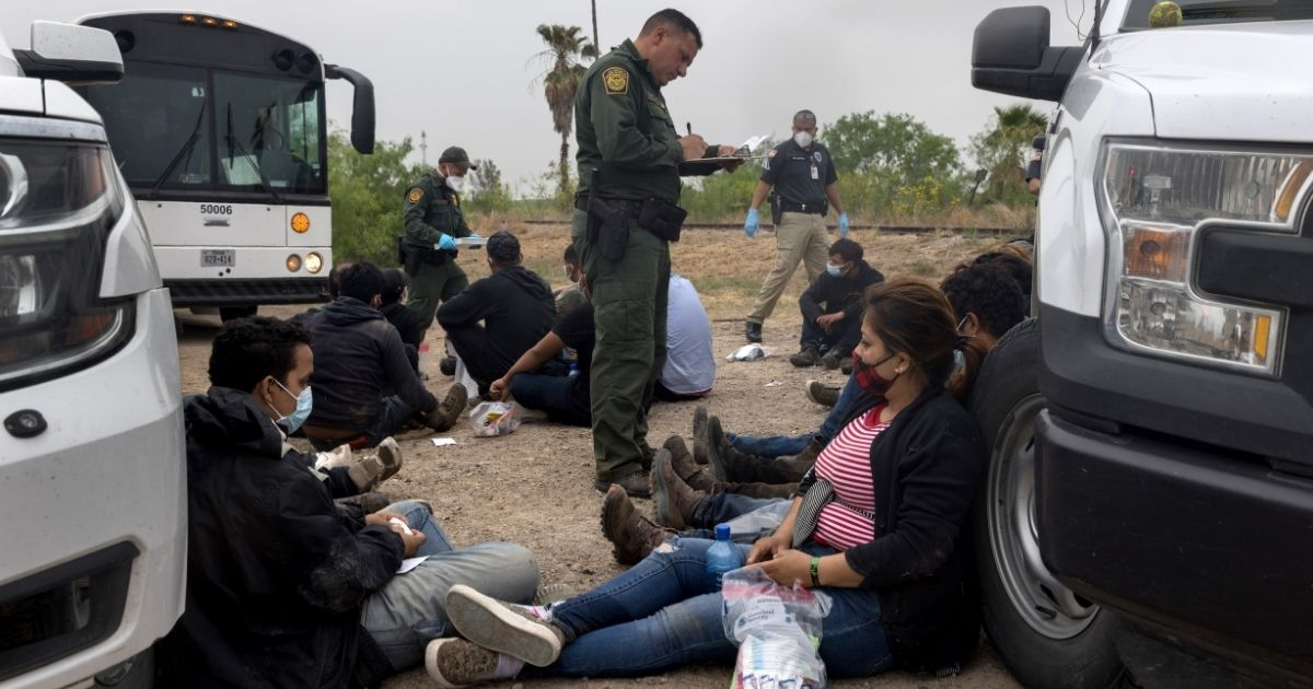 A U.S. Border Patrol agent registers immigrants Tuesday before they are taken to a processing center near the border in La Joya, Texas.