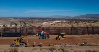 A construction crew works on building a 13-mile stretch of border wall in the desert between Sunland Park, New Mexico, and Ciudad Juarez, Mexico, on Jan. 15 during the last day of Donald Trump's presidency.