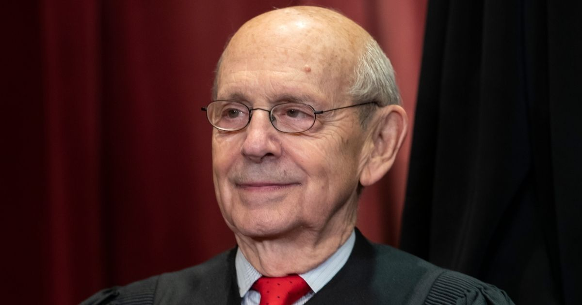Associate Justice Stephen Breyer sits with fellow Supreme Court justices for a group portrait at the Supreme Court Building in Washington on Nov. 30, 2018.