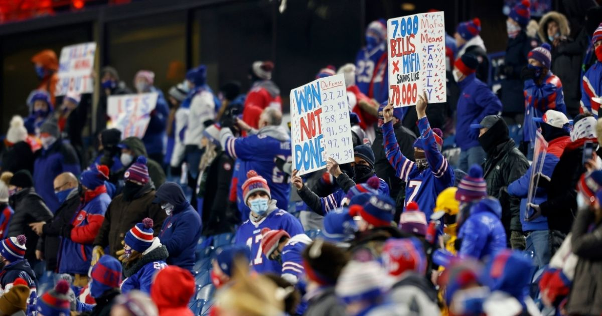 Fans hold signs prior to an AFC Divisional Playoff game between the Buffalo Bills and the Baltimore Ravens at Bills Stadium on Jan. 16, 2021, in Orchard Park, New York.