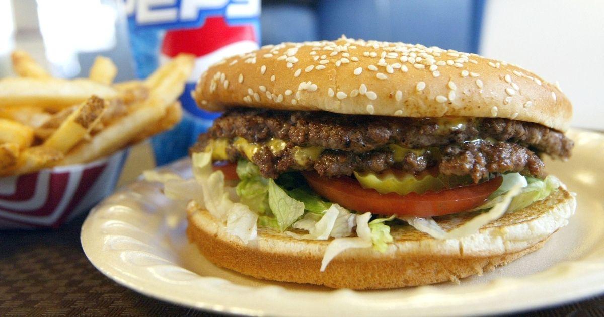 A double cheeseburger, fries and soda lie on a table at Majors Hamburgers on Dec. 28, 2003, in Yakima, Washington.