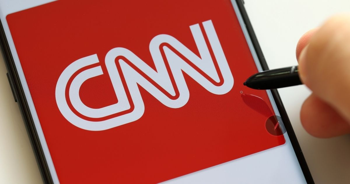 The CNN logo is pictured on a smartphone in the stock image above.