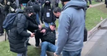 Members of a CNN media crew became the target of violent protesters on Wednesday night, as reporter Miguel Marquez was hit in the hear with a full water bottle.