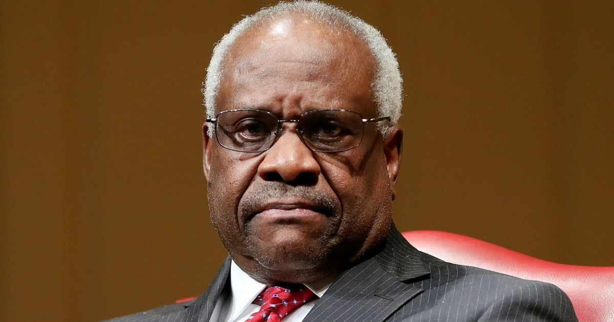 Supreme Court Justice Clarence Thomas sits as he is introduced during an event at the Library of Congress in Washington, D.C., on Feb. 15, 2018.