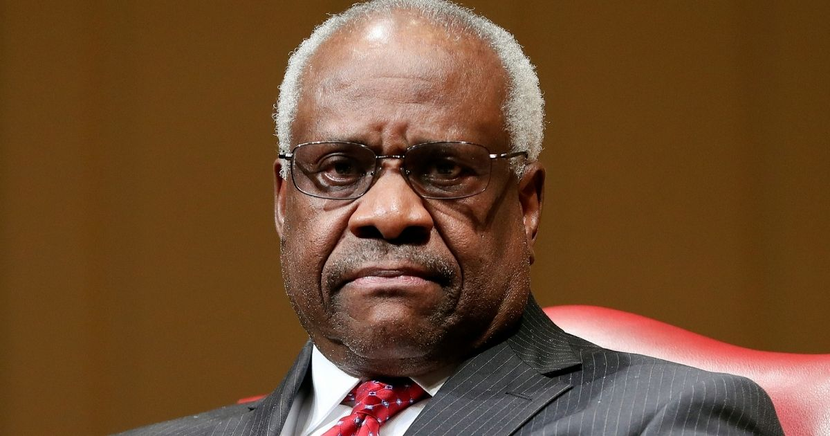Supreme Court Associate Justice Clarence Thomas sits as he is introduced during an event at the Library of Congress in Washington, D.C., on Feb. 15, 2018.