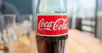 This photo portrays a close-up of the logo for Coca-Cola on a glass bottle in a restaurant setting in Walnut Creek, California, on March 4, 2021.