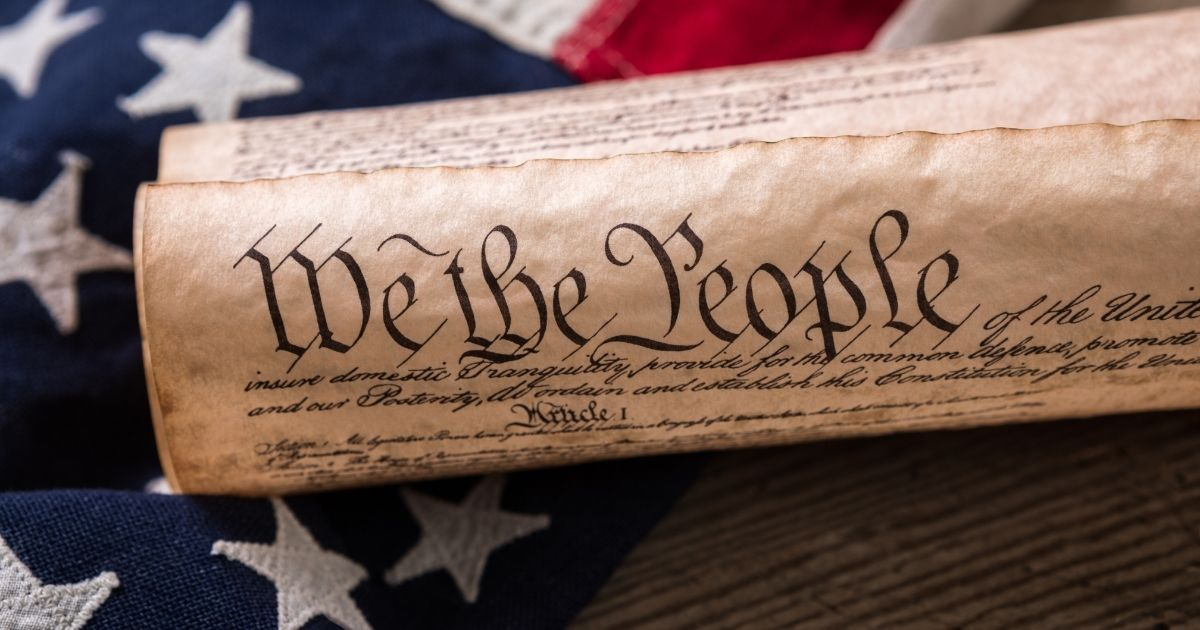 The U.S. Constitution is pictured in the stock image.