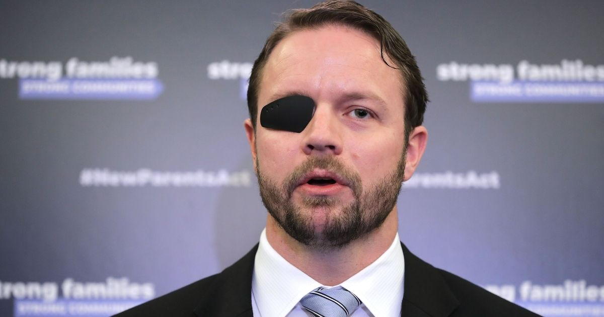 Republican Rep. Dan Crenshaw of Texas joins fellow Republicans from the House and Senate to introduce paid family leave legislation during a news conference in the Russell Senate Office Building on Capitol Hill on March 27, 2019, in Washington, D.C.