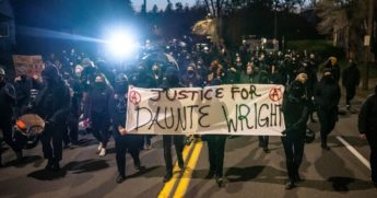 Activists march towards the Multnomah County Sheriff's office during a protest against the killing of Daunte Wright on Monday in Portland, Oregon.