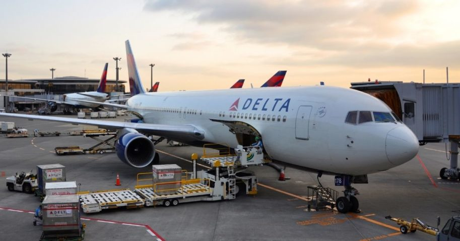 A Delta Air Lines plane is pictured at an airport in the stock image above.