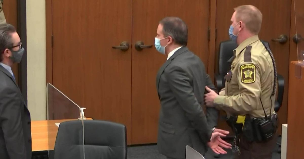 Former Minneapolis police officer Derek Chauvin is led from the courtroom after his trial in the case of the death of George Floyd.