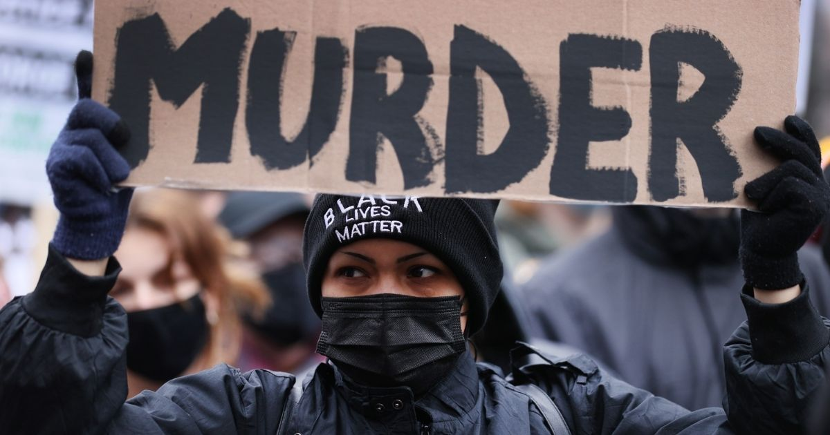 A demonstrator protests near the Hennepin County Courthouse on Monday in Minneapolis.