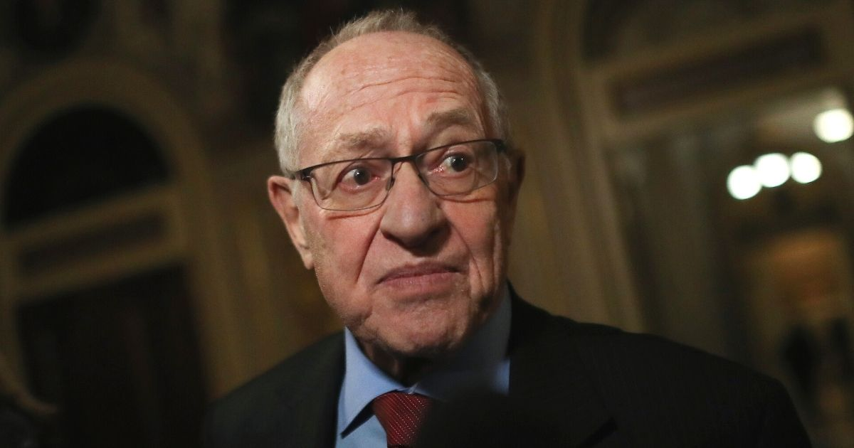 Attorney Alan Dershowitz, a member of then-President Donald Trump's legal team, speaks to the media in the Senate Reception Room during Trump's impeachment trial at the U.S. Capitol in Washington on Jan. 29, 2020.