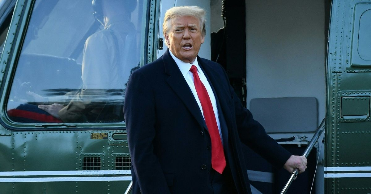 Then-President Donald Trump speaks as he boards Marine One at the White House in Washington, D.C., on Jan. 20, 2021.