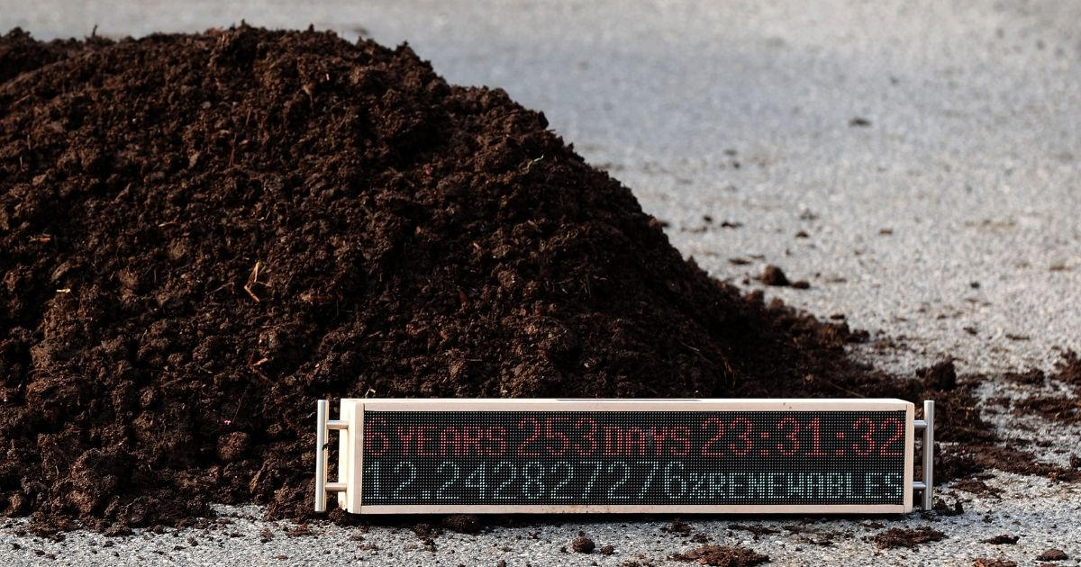 A countdown clock sits in a pile of manure left by activists outside the White House during a protest against President Joe Biden's climate change policy on Earth Day (Thursday) in Washington, D.C.